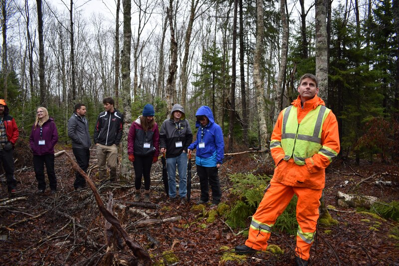 Halifax Water partner and forWater students in a forest