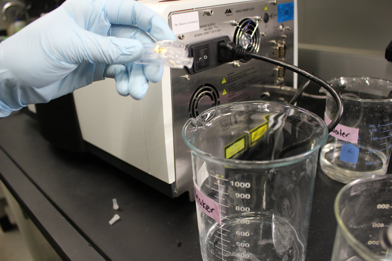 Preparing a water sample for analysis in the lab