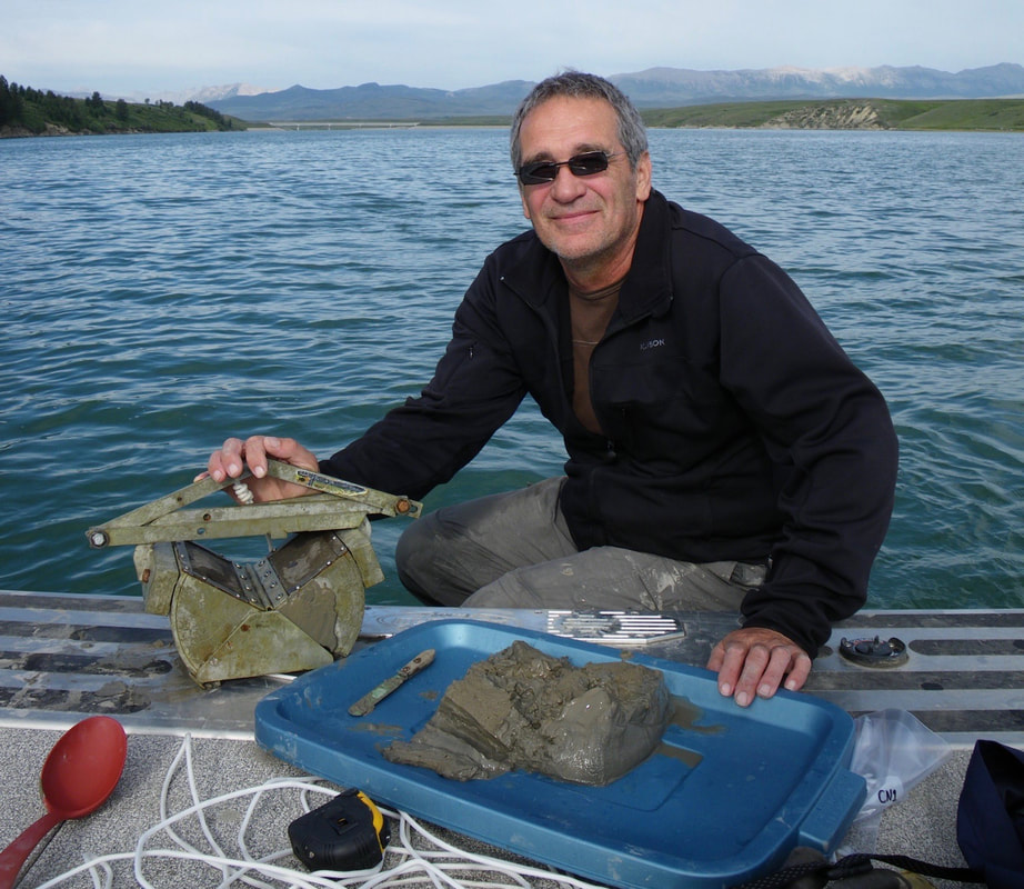 Mike Stone with a sediment sample on the boat on a lake